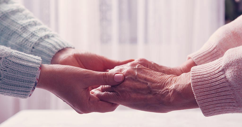 holding hands with elderly person