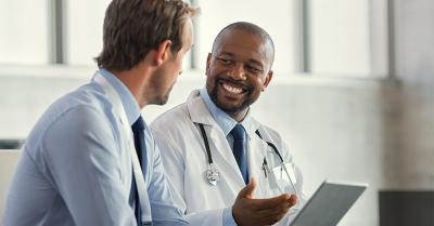 two male doctors talking